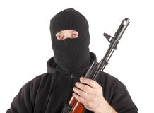 Man in mask with gun Stock Photography