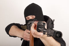 Man in mask with gun Royalty Free Stock Photos