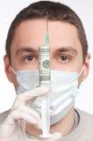 Man in mask holding money syringe closeup. Man portrait in mask holding with money syringe close-up royalty free stock photo