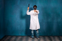 Man with mask and knife Stock Images
