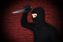 Man in mask with knife Stock Photography