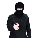 Man in a mask with a knife on a white Royalty Free Stock Photos