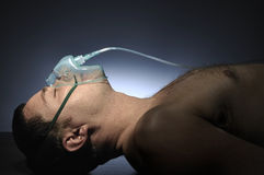 Man in mask oxygen. Stock Images