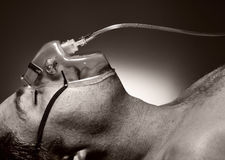 Man in mask of oxygen. royalty free stock images