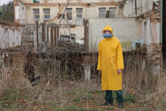 Man with  mask and protective clothes explores danger area                          r Stock Photos