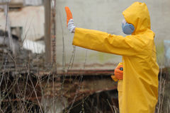 Man with  mask and protective clothes explores danger area                          r Stock Images