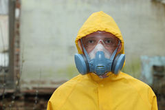 Man with  mask and protective clothes explores danger area                          r Stock Image