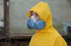 Man with  mask and protective clothes explores danger area                          r Royalty Free Stock Photography