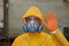 Man with  mask and protective clothes explores danger area                          r Royalty Free Stock Image