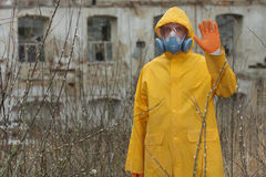 Man with  mask and protective clothes explores danger area                          r Stock Photography