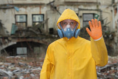 Man with  mask and protective clothes explores danger area                          r Royalty Free Stock Images