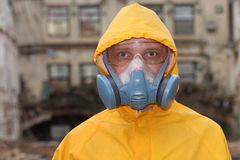Man with  mask and protective clothes explores danger area                          r Royalty Free Stock Photos