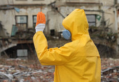 Man with  mask and protective clothes explores danger area                          r Royalty Free Stock Photo