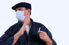 Man in mask repelled by cigarette Royalty Free Stock Photos