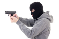 Man in mask shooting with gun isolated on white Royalty Free Stock Images