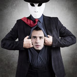 Man in mask. Showing his true face, concept Stock Image