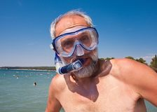 A man with a mask and snorkel Royalty Free Stock Image