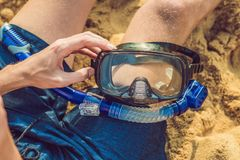 A man with a mask and snorkel is going to dive into the sea.  Royalty Free Stock Images