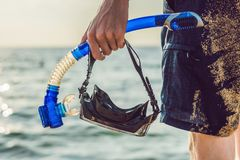 A man with a mask and snorkel is going to dive into the sea.  Stock Images