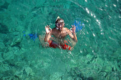 Man with mask snorkeling and doing ok sign Royalty Free Stock Photography