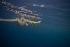 Man with mask snorkeling. Green eyed man with mask snorkeling. Red Sea Stock Images