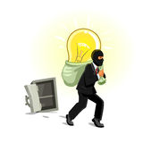 Man in mask stealing lamp from safe. Idea theft. Man stealing lamp bulb from safe box. Business metaphor of human thief in black mask stealing idea, intellectual Royalty Free Stock Images