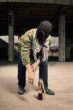 Man in mask taking flammable bottle to use it Stock Images