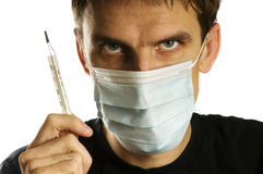 Man with mask and thermometer Royalty Free Stock Image