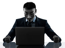Man masked anonymous group member computing computer silhouette Stock Photo