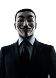 Man masked anonymous group silhouette portrait. PARIS– OCTOBER 30 : one man dressed and masked as a member of Anonymous underground group on October 30, 2012 Stock Photos