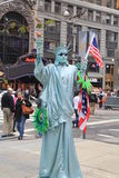 Man masked as statue of liberty Stock Photography