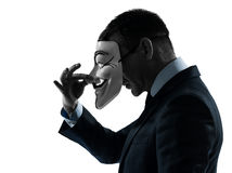 Man maskerad anonym gruppkonturstående arkivfoton