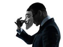 Man maskerad anonym gruppsilhouettestående royaltyfria foton