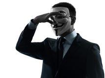 Man maskerad anonym gruppsilhouettestående royaltyfri bild