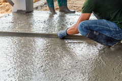 Man mason building a screed coat cement Stock Photo