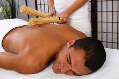 Man Massage. Young man receiving massage - SPA Royalty Free Stock Photography