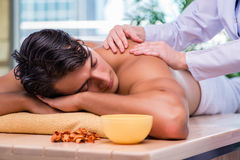 The man during massage session in spa salon Stock Photography