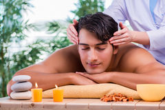 The man during massage session in spa salon Stock Photos