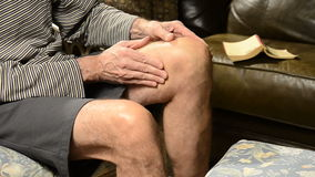 Man massaging knee in pain Royalty Free Stock Photography