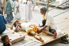 Massage in Varanasi Ghat, India royalty free stock photo