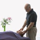 Man massaging woman. Royalty Free Stock Photos