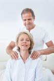 Man Massaging Woman's Shoulder Stock Photos
