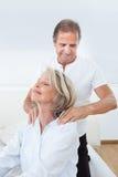 Man massaging woman's shoulder Royalty Free Stock Image