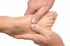 Man massaging womans foot Stock Images