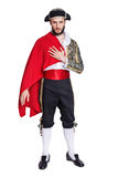 Man in a matador costume with a red cape. Isolated on a white background Stock Photos