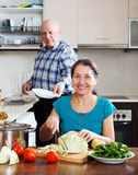 Man and mature woman  doing housework together Royalty Free Stock Image