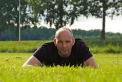 Man on a meadow looking at camera Stock Photography