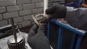 Male measuring with electronic caliper. A man measures an electronic caliper washers stock video footage