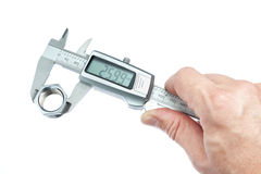 A man measures the piece caliper. Stock Image
