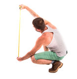 Man measures the wall stock image